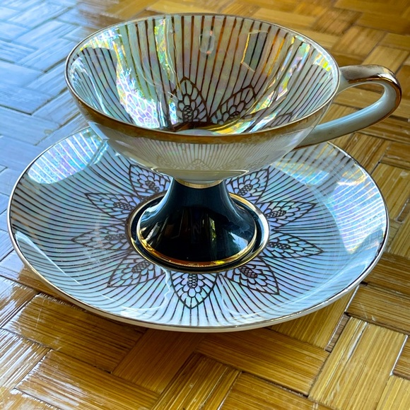 Black & white iridescent tea cup & saucer w/gilt